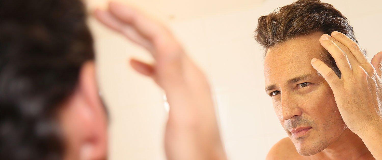 Geheimratsecken Haarmacherei